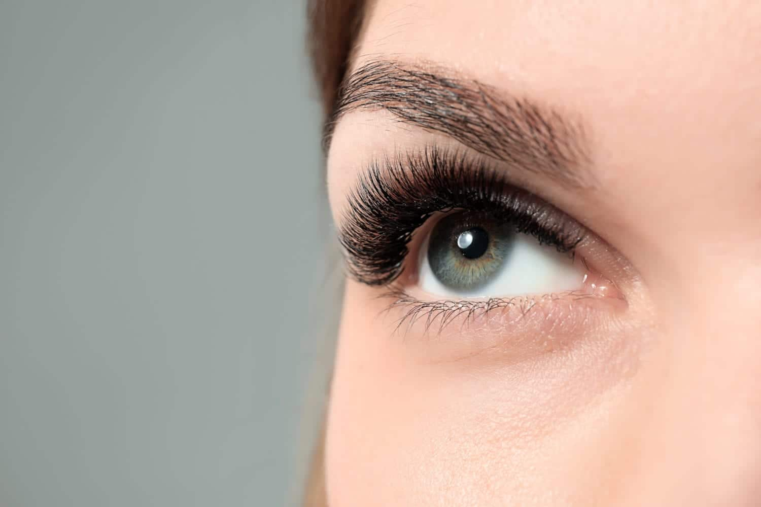 Young woman with beautiful silk eyelash extensions.
